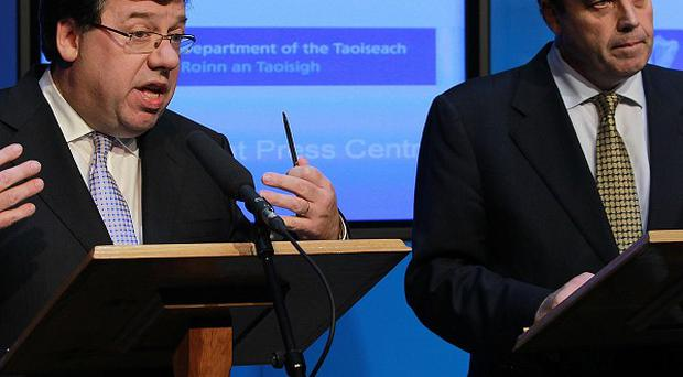Brian Cowen and Brian Lenihan announce that the Government will seek a bailout loan from the IMF