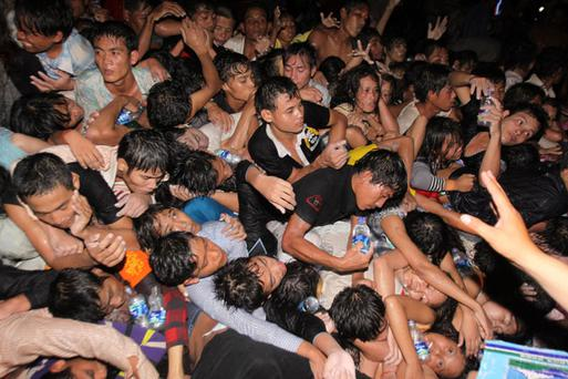 A crowd of Cambodians are pushed onto a bridge on the last day of celebrations of a water festival in Phnom Penh, Cambodia