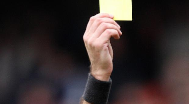 Scotland's top football referees are planning to strike