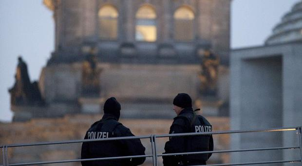 Police officers stand guard near the Reichstag building, which has been closed to visitors amid a terror alert
