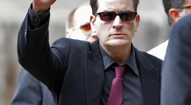 Charlie Sheen has launched a blackmail action against Capri Anderson (AP)