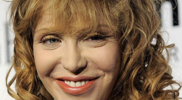 Courtney Love is being sued over some borrowed jewellery she is believed to have lost (AP)