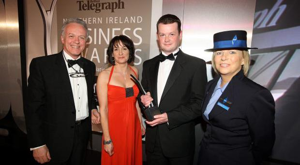 Edel Doherty from Women in Business presents Greg Wilson with the Young Businessperson of the Year award. They are flanked by master of ceremonies Noel Thompson and Tracey Maxwell from bmi