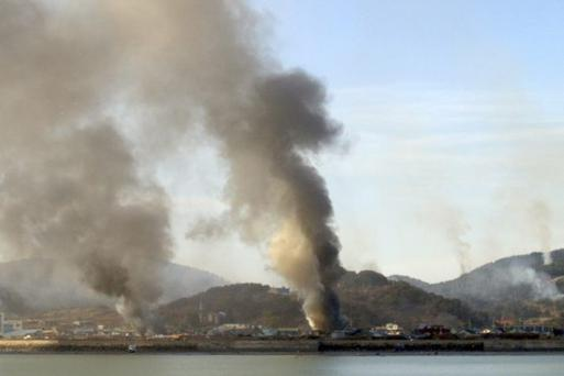 Smoke rises from South Korea's Yeonpyeong island near the border against North Korea Tuesday, Nov. 23, 2010.