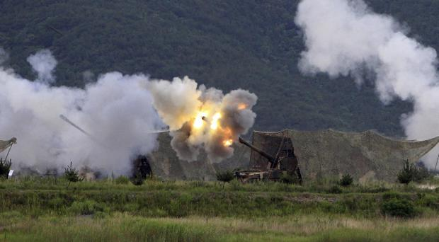 FILE FILE In this photo taken Friday, Aug. 2, 2010, South Korean Marines self-propelled artillery K-9 howitzers fire during a military drill against possible attacks from North Korea on Baengnyeong Island, South Korea. North Korea shot dozens of rounds of artillery onto the populated South Korean island near their disputed western border Tuesday, Nov. 23, 2010, military officials said, setting buildings on fire and prompting South Korea to return fire and scramble fighter jets. (AP Photo/Yonhap, Suh Myung-gon) KOREA OUT