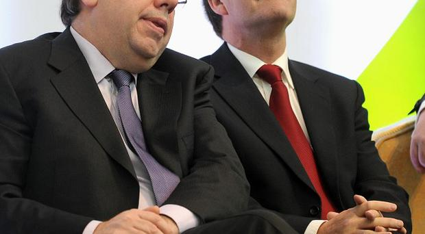Transport Minister Noel Dempsey, pictured with Taoiseach Brian Cowen, says the bailout is only secure with a Goverment savings plan