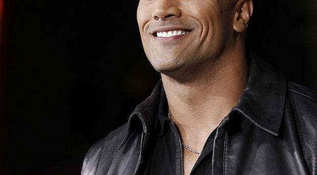 Dwayne Johnson says he'd be a great Superman