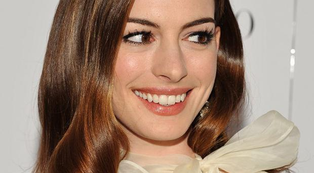 Anne Hathaway could be playing Lois Lane