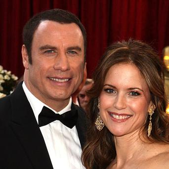 John Travolta and Kelly Preston are celebrating the arrival of a baby boy