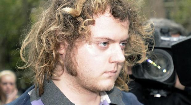 Edward Woollard admitted throwing a fire extinguisher from a rooftop during the Millbank riot