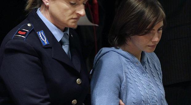 Amanda Knox is escorted into the courtroom (AP)