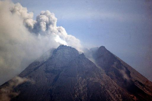 Mount Merapi spews volcanic material as seen from Sleman, Indonesia