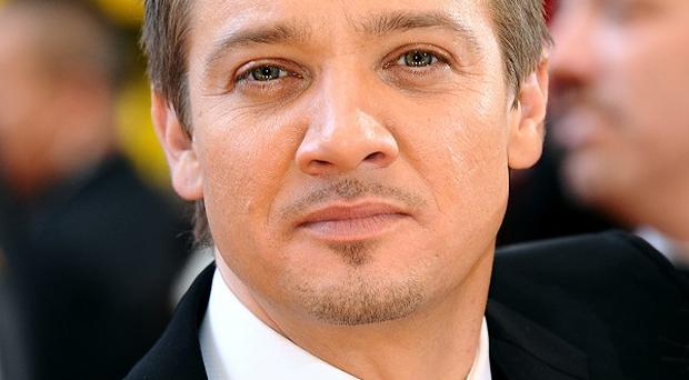 Jeremy Renner is working out to try and be as strong as Tom Cruise