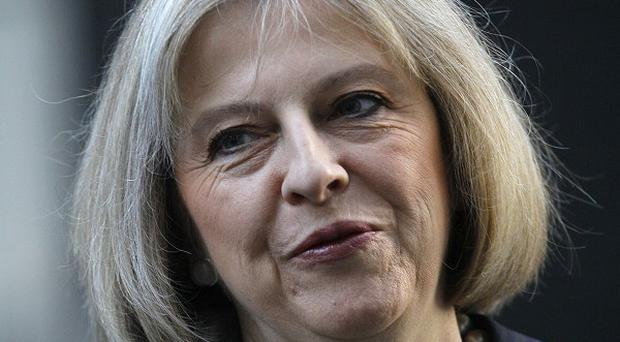 Suspected wife-beaters could be banned from their homes under plans unveiled by Theresa May