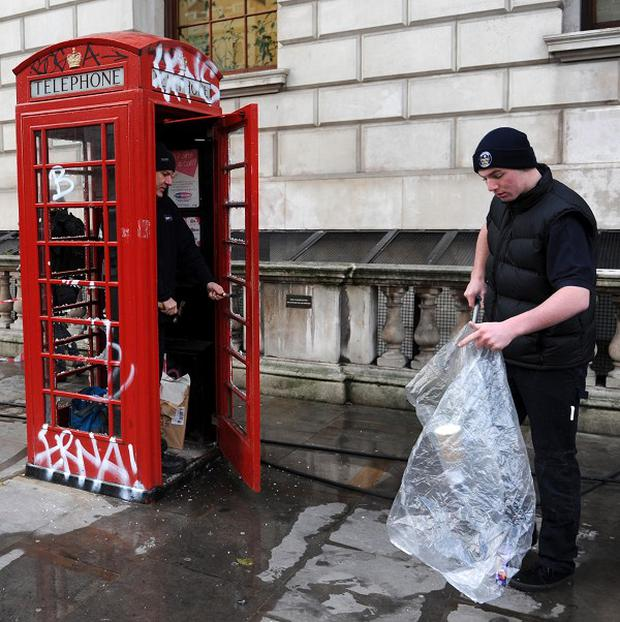 Debris is cleared up in Whitehall after demonstrations against the proposed rise in tuition fees
