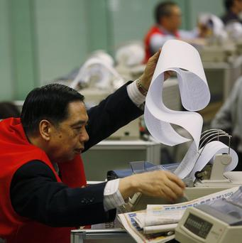 Hong Kong Stock Exchange stockbrokers' long lunch is coming to an end (AP)