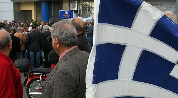 About 250 people protested against pension cuts and health reforms in Athens (AP)