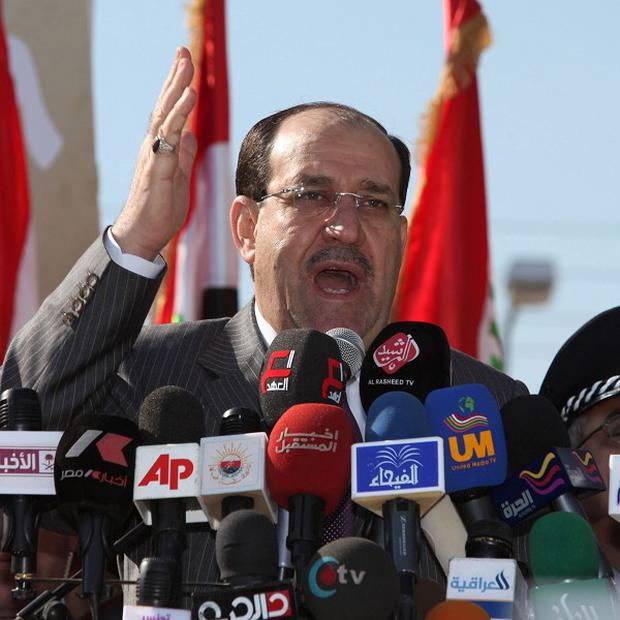 Iraq's Prime Minister Nouri al-Maliki has been asked to form a new government (AP)