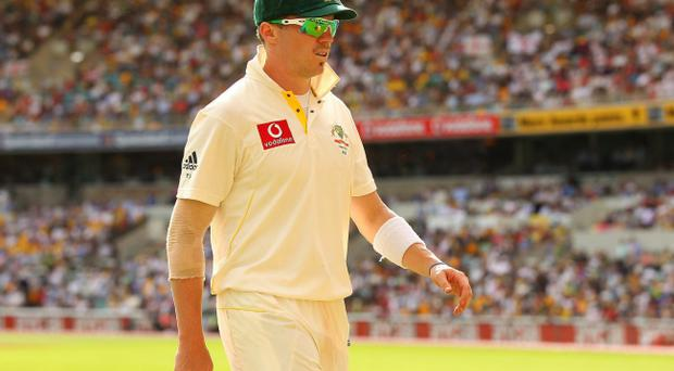 Peter Siddle of Australia walks to the boundary during day one of the First Ashes Test match between Australia and England at The Gabba on November 25, 2010 in Brisbane, Australia.