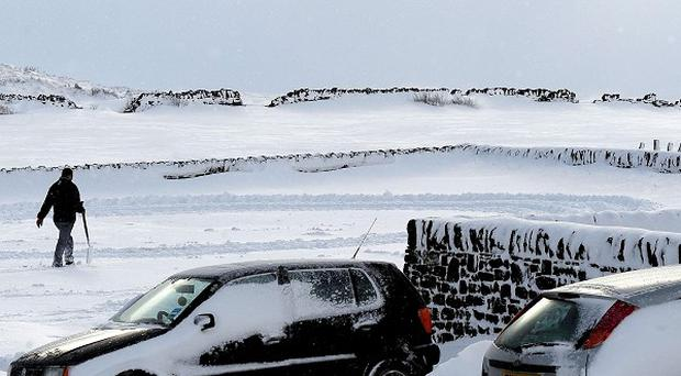 Deep snow and drifts on roads near Castleton, North Yorkshire