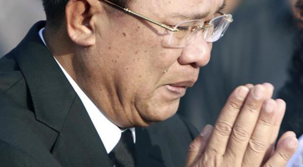 Cambodia's prime minister Hun Sen weeps during a memorial service for victims of the stampede (AP)