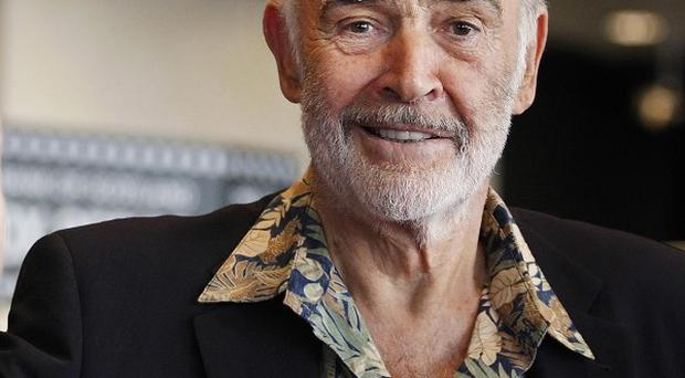A gun once held by Sean Connery while promoting James Bond has been sold for more than a quarter of a million pounds