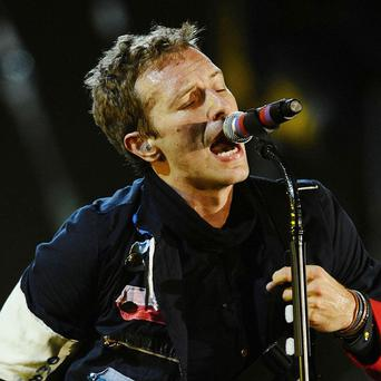 Chris Martin says he'll make a stand with the new Coldplay album