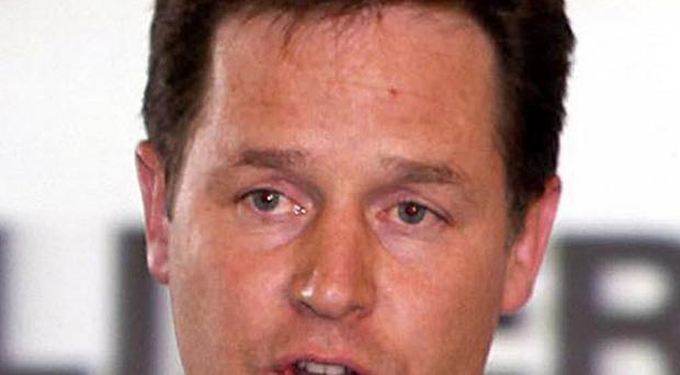 Nick Clegg has declined to rule out Lib Dem ministers abstaining in the parliamentary vote on tuition fees