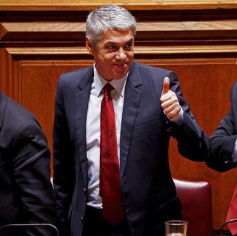 Portuguese PM Jose Socrates gives a thumbs-up after the austerity plan was passed (AP)