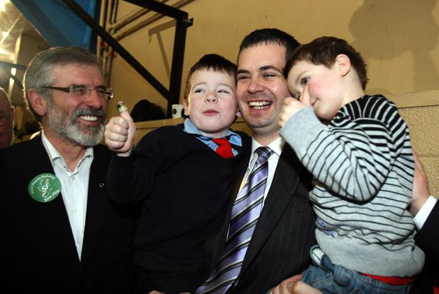 Sinn Fein's Pearce Doherty, with his children Padraig (left) and Colm (right), and Sinn Fein President Gerry Adams, at the election count in Donegal