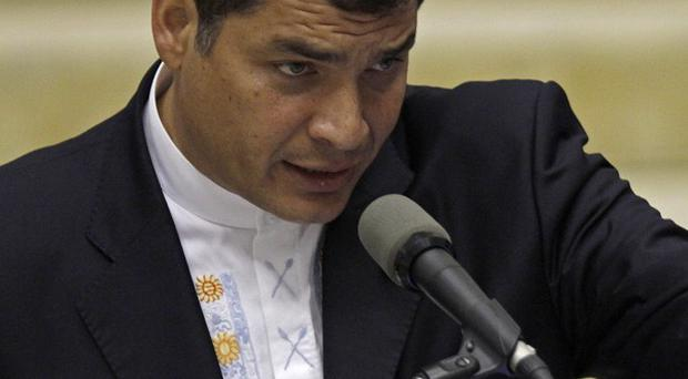 Ecuador's president Rafael Correa delivers a speech during the Unasur summit (AP)