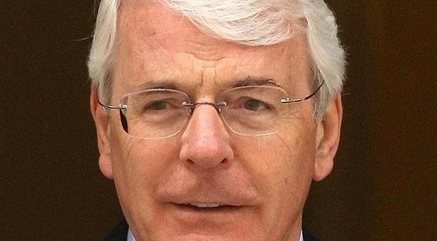 Sir John Major has said the Conservative-Liberal coalition could continue past the 2015 election