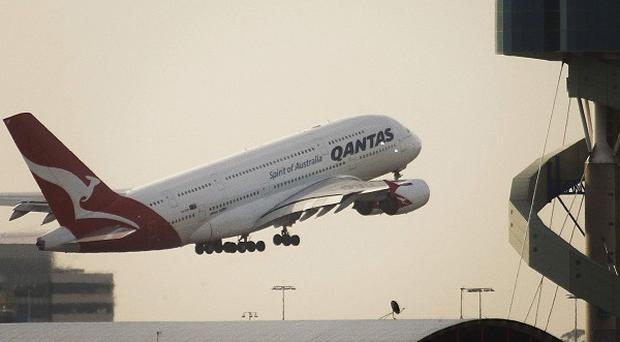 A Qantas A380 superjumbo takes off in Sydney for the first time since a midair engine explosion (AP)