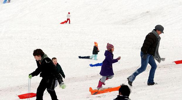 Children enjoy the snow in Whitley Bay in North Tyneside