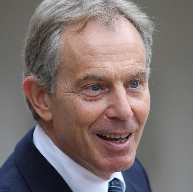 Tony Blair has defended religious faith as a force for good in the world during a television debate