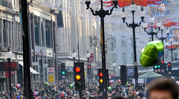 Christmas shoppers pack London's Regents Street