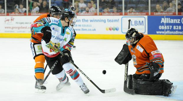 Craig Peacock of the Belfast Giants sees his shot saved by Ervins Mustukovs of the Sheffield