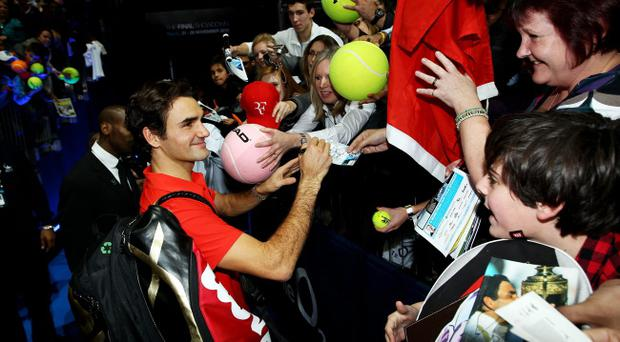 LONDON, ENGLAND - NOVEMBER 28: Roger Federer of Switzerland signs autographs after defeating Rafael Nadal of Spain in the men's final match during the ATP World Tour Finals at O2 Arena on November 28, 2010 in London, England. (Photo by Julian Finney/Getty Images)
