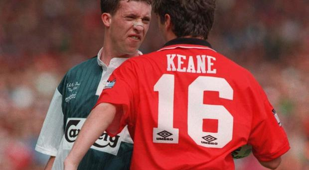 Robbie Fowler and Roy Keane clash during the 1996 FA Cup final between the teams, which United won to clinch a second league and cup double