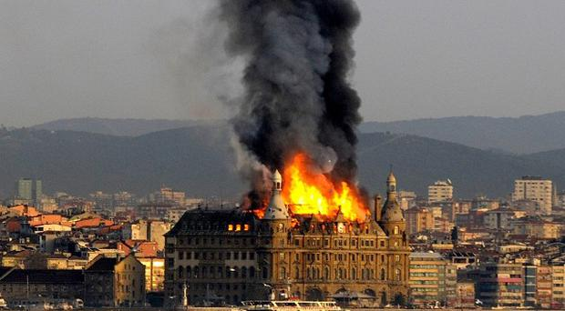 Flames and smoke rise from the roof of Istanbul's historic Haydarpasa train station