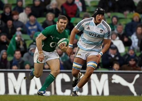 Ireland's Geordan Murphy runs through the Argentinan defence during the Guinness Series match at the Aviva Stadium, Dublin, Ireland. PRESS ASSOCIATION Photo. Picture date: Sunday November 28, 2010. See PA Story RUGBYU Ireland. Photo credit should read: Liam McBurney/PA Wire.
