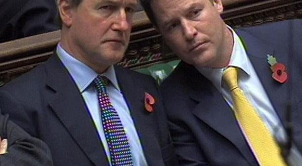 Secretary of State for Northern Ireland Owen Paterson, seen with Deputy Prime Minister Nick Clegg, has urged Northern Ireland to set a budget