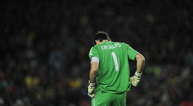 BARCELONA, SPAIN - NOVEMBER 29: Iker Casillas of Real Madrid looks down after Pedro Rodriguez scored the second goal against Real Madrid during the La Liga match between Barcelona and Real Madrid at the Camp Nou Stadium on November 29, 2010 in Barcelona, Spain. Bacelona won 5-0. (Photo by David Ramos/Getty Images)