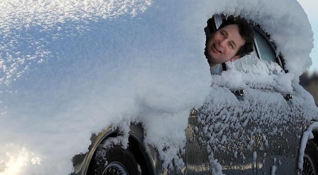A man looks out from his snow covered car in Doune, Stirling, as heavy snowfall continues across Scotland and the North East