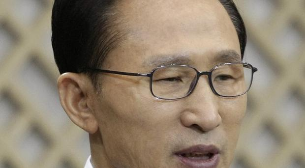 South Korean president Lee Myung-bak said he had 'failed to protect' residents of Yeonpyeong island (AP)