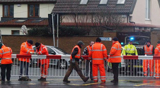 Railway workers at a level crossing in Dublin