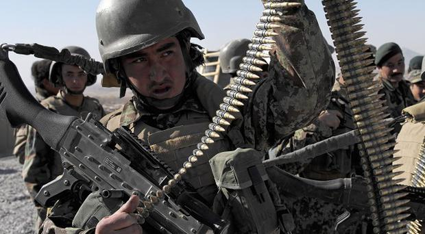 Afghan national army soldiers come under frequent attacks from insurgents (AP)