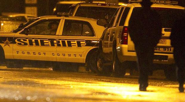 Police stationed at Marinette High School during a hostage situation in which a teenage gunman shot himself (AP)