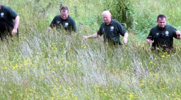 Police search land owned by Colin Howell, near Castlerock
