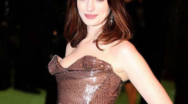 Anne Hathaway is to co-host the Oscars in February